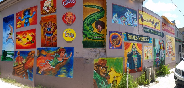 many different murals on one wall