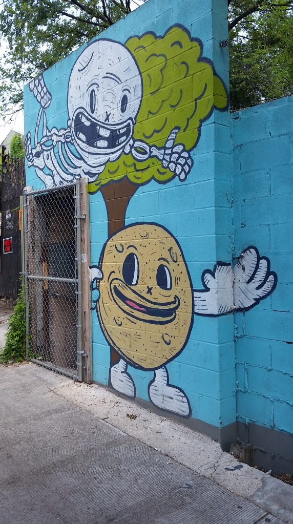 funny looking pacman, traveling in Austin, graffiti and cannabis
