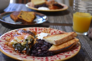 Quinoa chili rellenos, black beans, sour cream and toast.