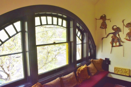 Upstairs window seat with a gorgeous arch window.
