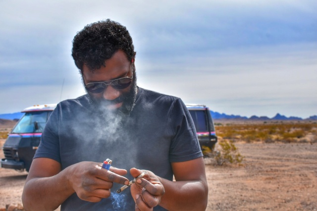 Smoking a hundred dollar bill in the Desert
